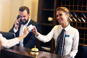 Picture,Of,Guests,Getting,Key,Card,In,Hotel